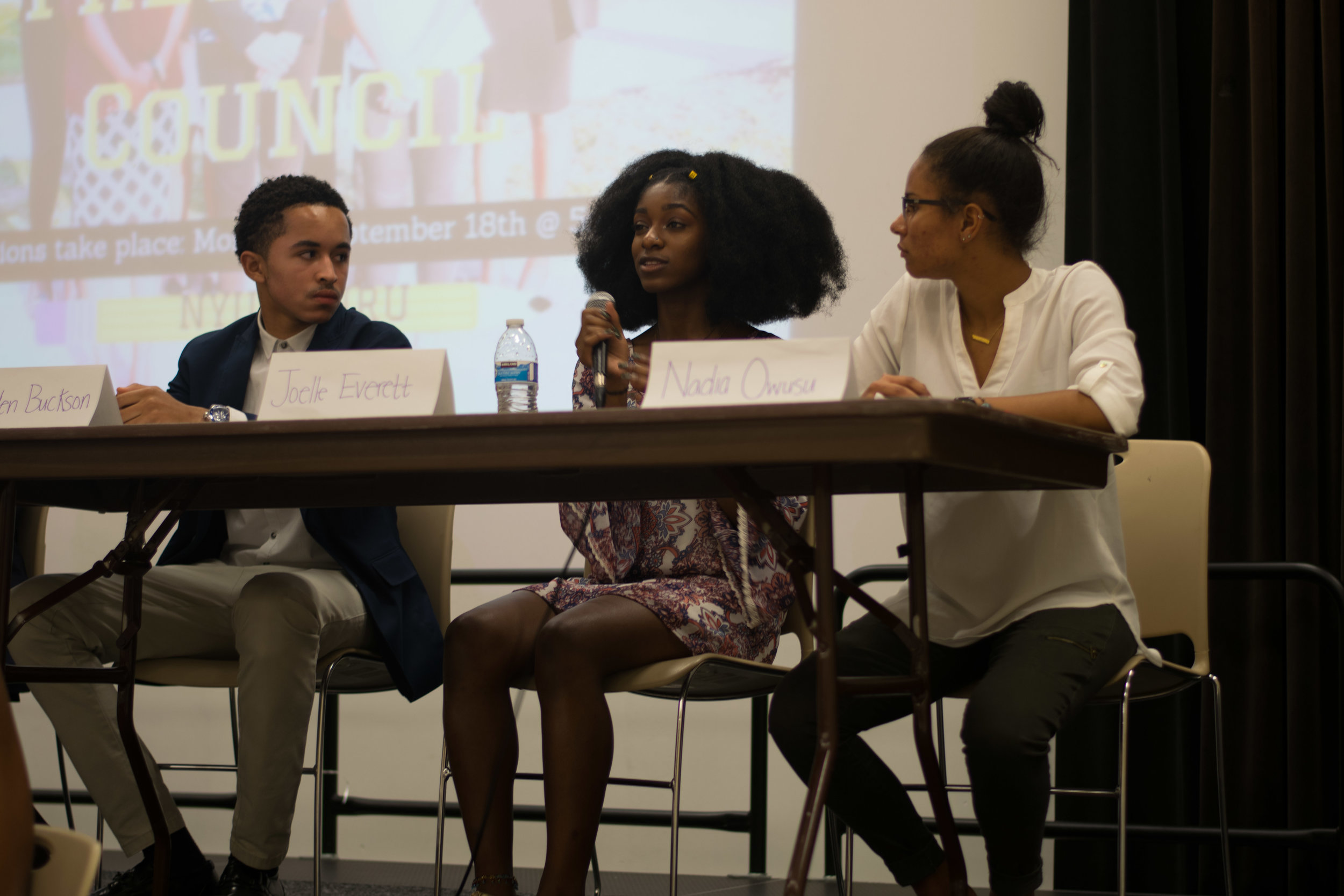 Landen Buckson (left), Joelle Everett (middle), and Nadia Owusu (right) answer a question from an audience member at the 2017-2018 Black Student Union Freshman Council elections on Monday, Sept. 18, 2017. This person asked what is one goal the candidates would like to achieve if elected vice president of the council. Photo by Amina Lampkin.