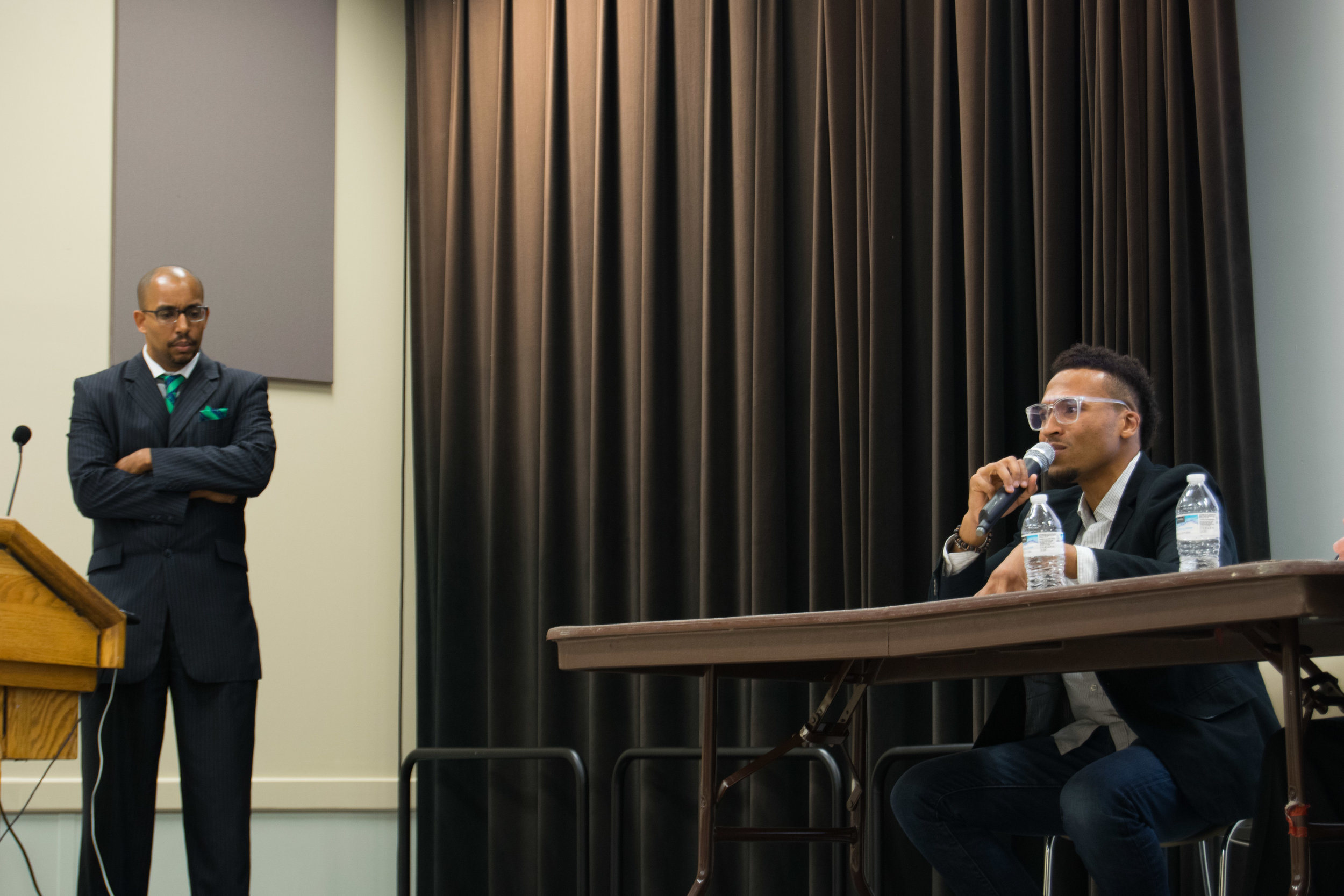 """Aaron T. O'Neal, attorney, activist, and organizer of Black is Back Coalition, responds to moderator Gregory D. Yancey's question at the Do Good Dialogue: Hands Up, Don't Shoot! hosted by The Clarice on Tuesday, Sept. 26, 2017. O'Neal reflected on the slogan """"Hands up, don't shoot"""" coming out of a necessity for a gentler struggle during the Ferguson protests. Photo: Amina Lampkin"""