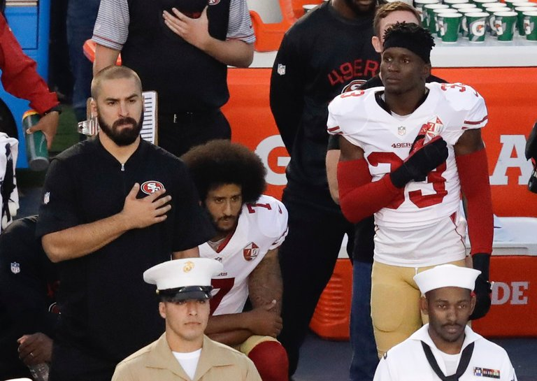 In August 2016, former 49ers quarterback Colin Kaepernick started a silent protest during the National Anthem by sitting and kneeling to take a stand against police brutality and show support to the oppressed African Americans. His protest immediately gained wide-spread attention and some support with other NFL players. Photo:Chris Carlson AP