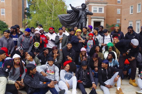 On Thursday October 26, 2017, students pose in their colorful durags, silk scarves, and bonnets in front of Frederick Douglass statue at Hornbake Library in support of UMD Durag Day and #Alleyezonumd. Photo by Aleah Green