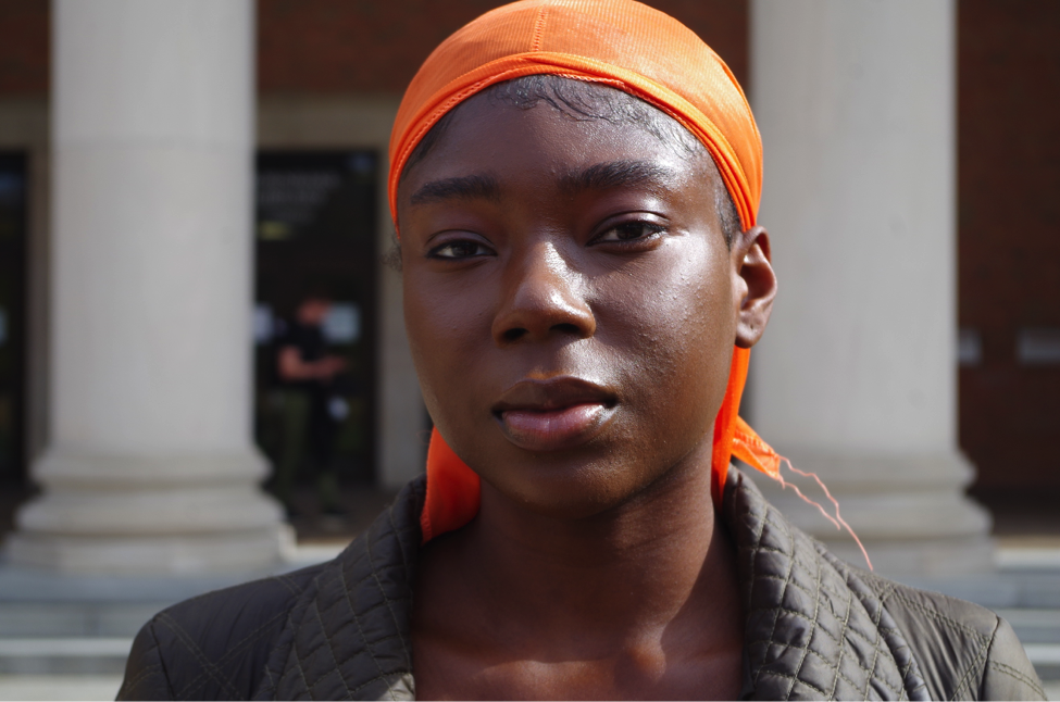 Maud Acheampong rocks an orange durag for fashion, style and an embrace of black culture. Photo by Aleah Green.