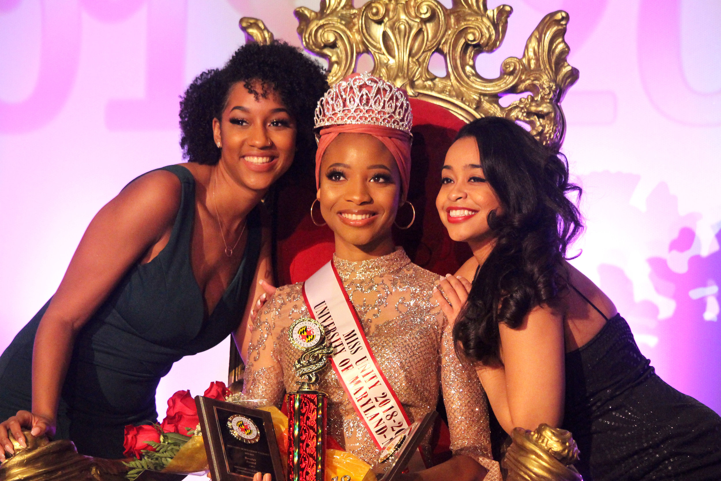 Jeyda Muhammad, the winner of this year's Miss Unity Scholarship Pageant, sits on the decorative throne between Rae-Ann Steele (left) and Cathryn Paul (right) for a series of posed portraits at the Hoff Theater in College Park, Md. on Sunday, Nov. 11, 2018. (Alexandra Glover/The Black Explosion)