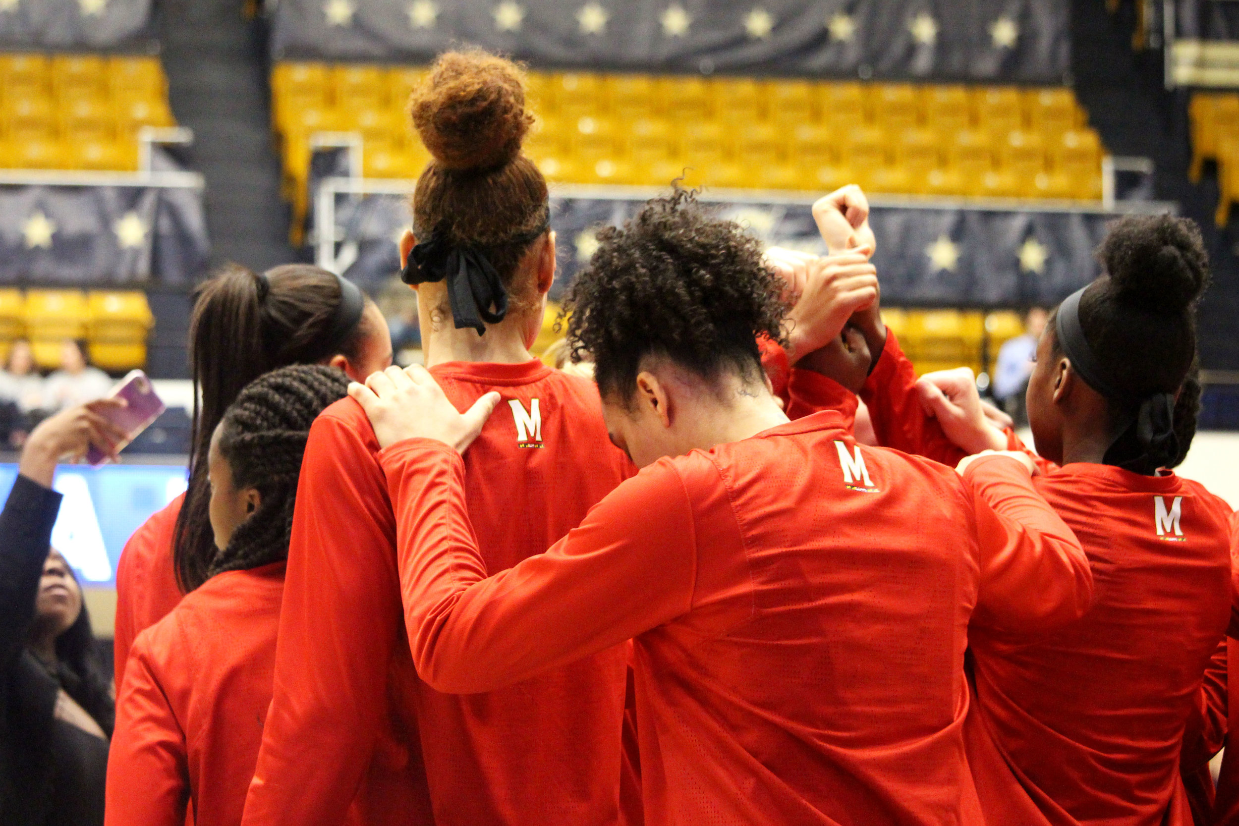 The Maryland women's basketball team assembles together in a tight huddle on the court after warming up for their evening matchup against George Washington at the Charles E. Smith Center in Washington on Wednesday, Nov. 14, 2018. The Terps won 69-30. (Alexandra Glover/The Black Explosion)