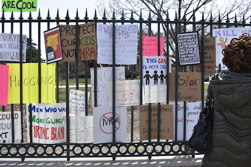 Protestors stuck their signs on fences in downtown Washington D.C. after the 2018 student-led demonstration calling for gun reform, March for Our Lives. (Iman Hassen/The Black Explosion)