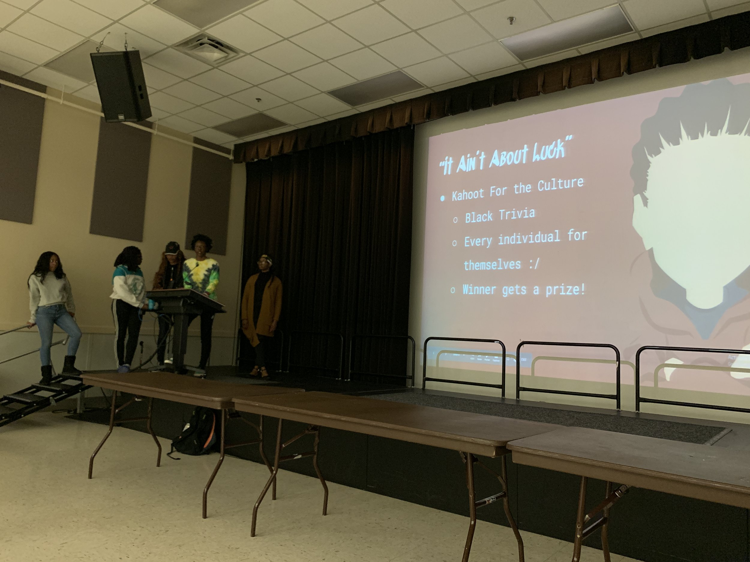 Members of the Black Student Union's Freshman Council explain the instructions and rules for the game of Kahoot! on Monday, April 1. (Amina Lampkin/The Black Explosion)