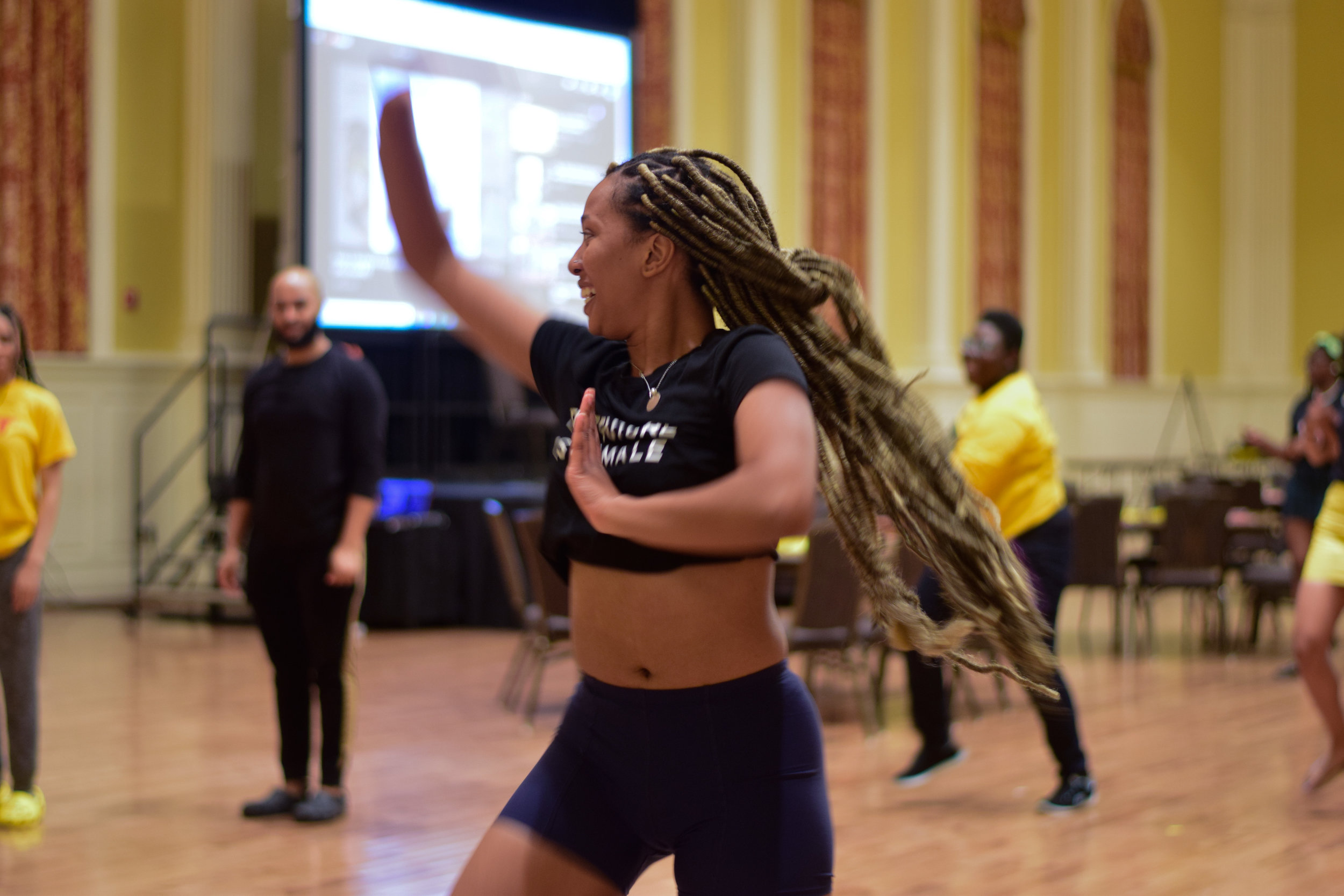 Nthabiseng Cooper, a sophomore government and politics and African American studies double major, teaches attendees the first half of some choreography at Maryland MANE's My Black Is Beautiful event on April 17. Cooper is a dancer on Riddim Ryderz, a Caribbean dance troupe. (Amina Lampkin/The Black Explosion)