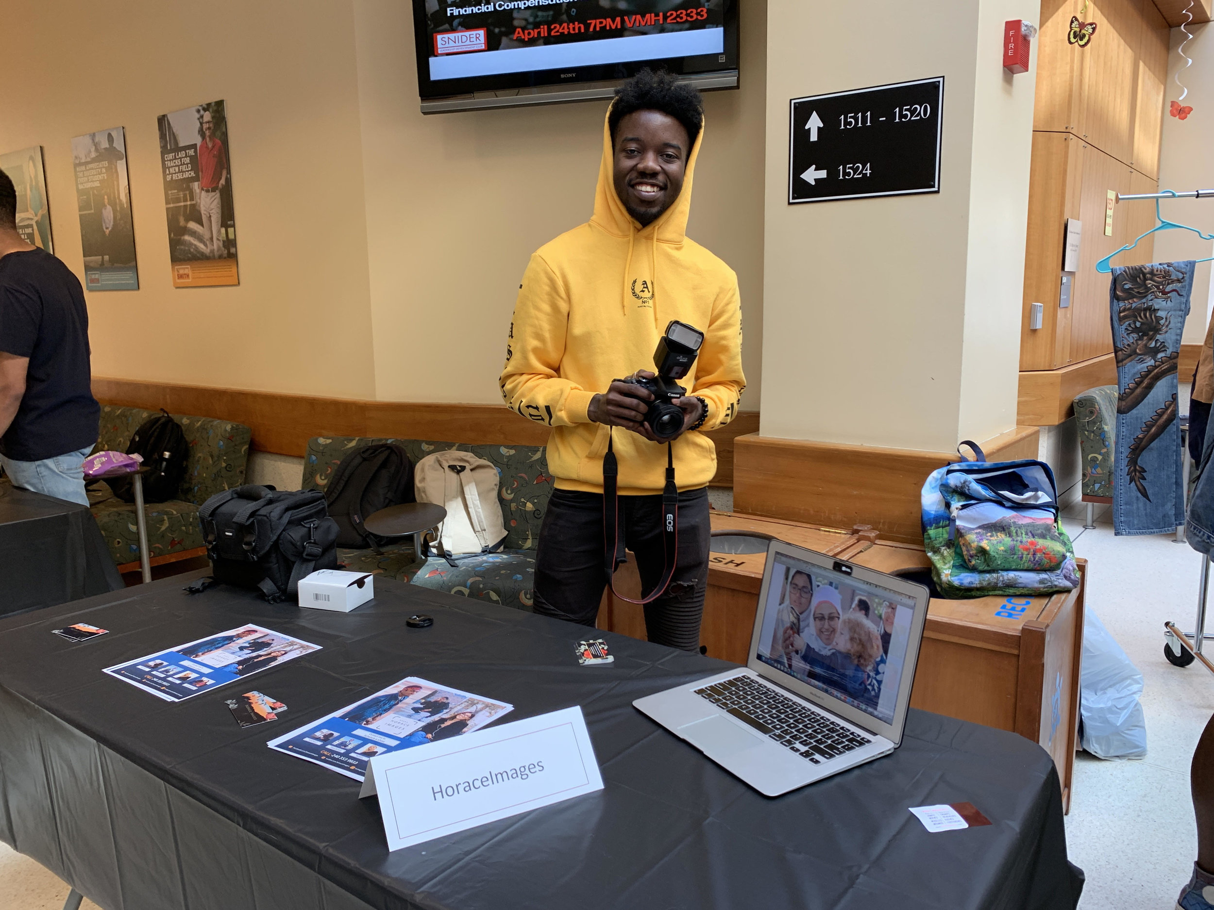 Chris Wright, a senior communications major, poses with his table at the Terp Marketplace on Wednesday, April 10 in the Pownall Atrium in Van Munching Hall.