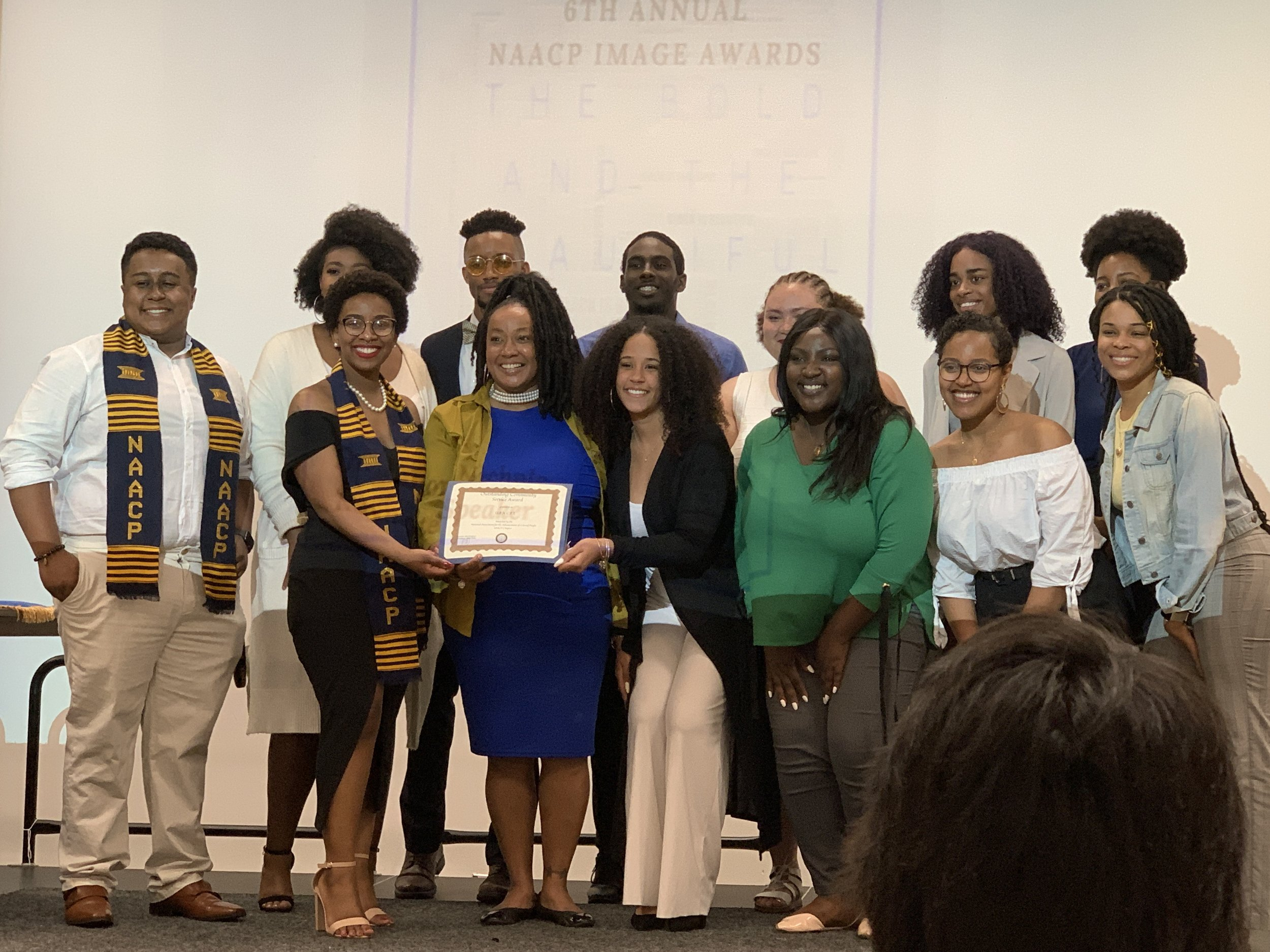Members of Unified Engaging eXperience Committed to Empowering Leadership accept the University of Maryland College Park chapter of the National Association for the Advancement for Colored People Image Award for community service on Monday, May 6, 2019. U.E.X.C.E.L. aims to teach students of color the skills they need to become leaders on campus. (Amina Lampkin/The Black Explosion)