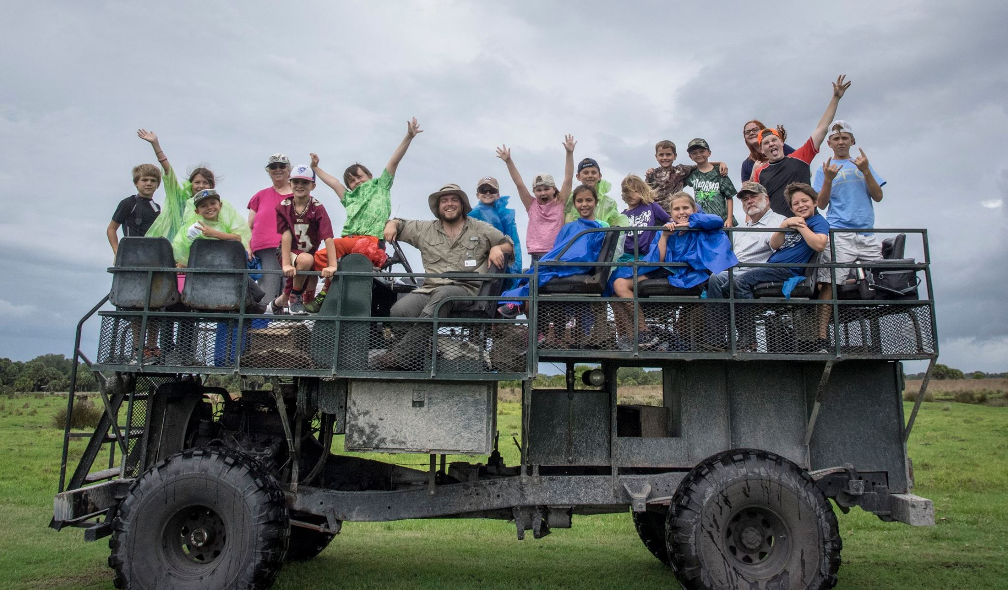 Dustin Angell leads summer camp students on a buggy tour. Photo courtesy of Archbold Biological Station.