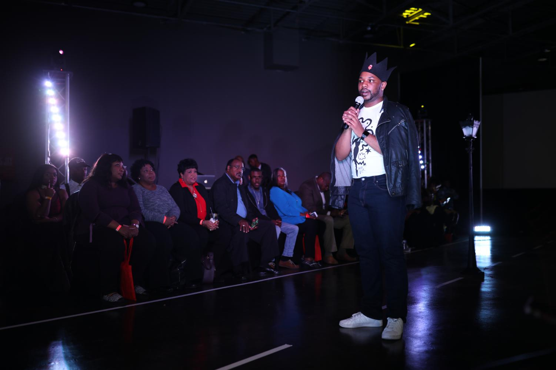 Derek DeAndre addresses the crowd from the runway at Magic City Fashion Week. CW/ Joe Will Field