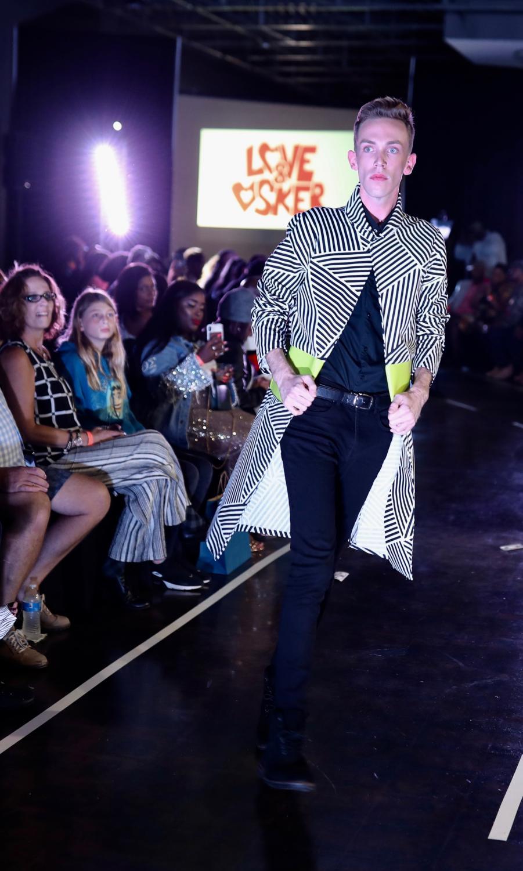 """A model walks the runway wearing Derek DeAndre's """"Love & Osker"""" line. CW/ Joe Will Field"""