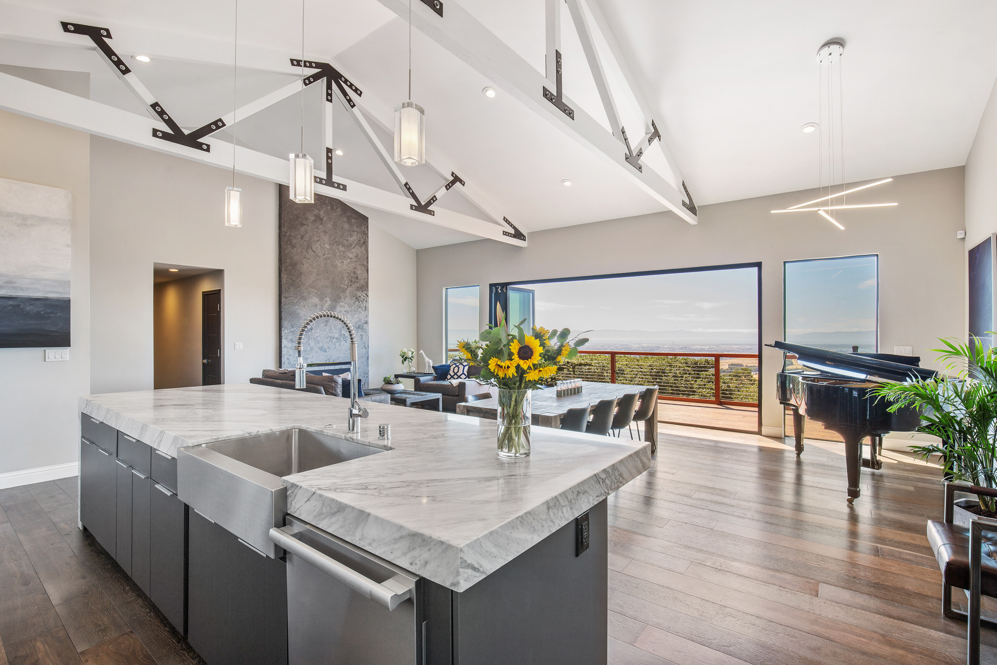 Open kitchen concept with a panoramic, 3 bridge view of the Bay and San Francisco. 8' La Cantina Bifolding Door System spanning 23'.