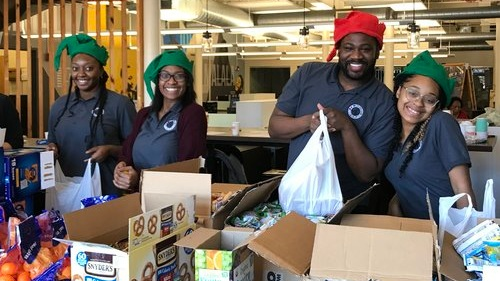 2018/19 AmeriCorps members pack meals for students during the winter break.