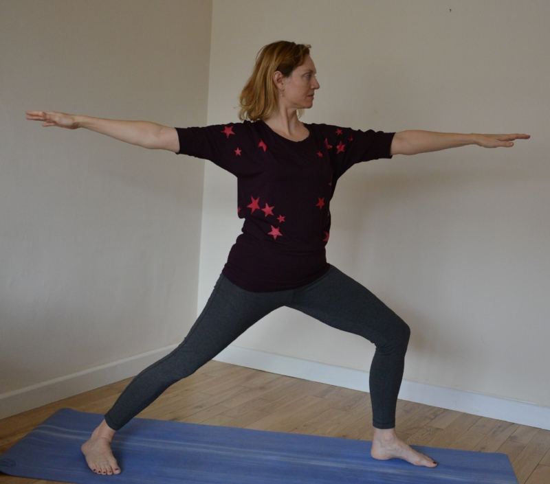 Virabhadrasana II - On an exhale, open your arms in-line with your legs until they are parallel to the floor, allow your back hip to open to side a little too.