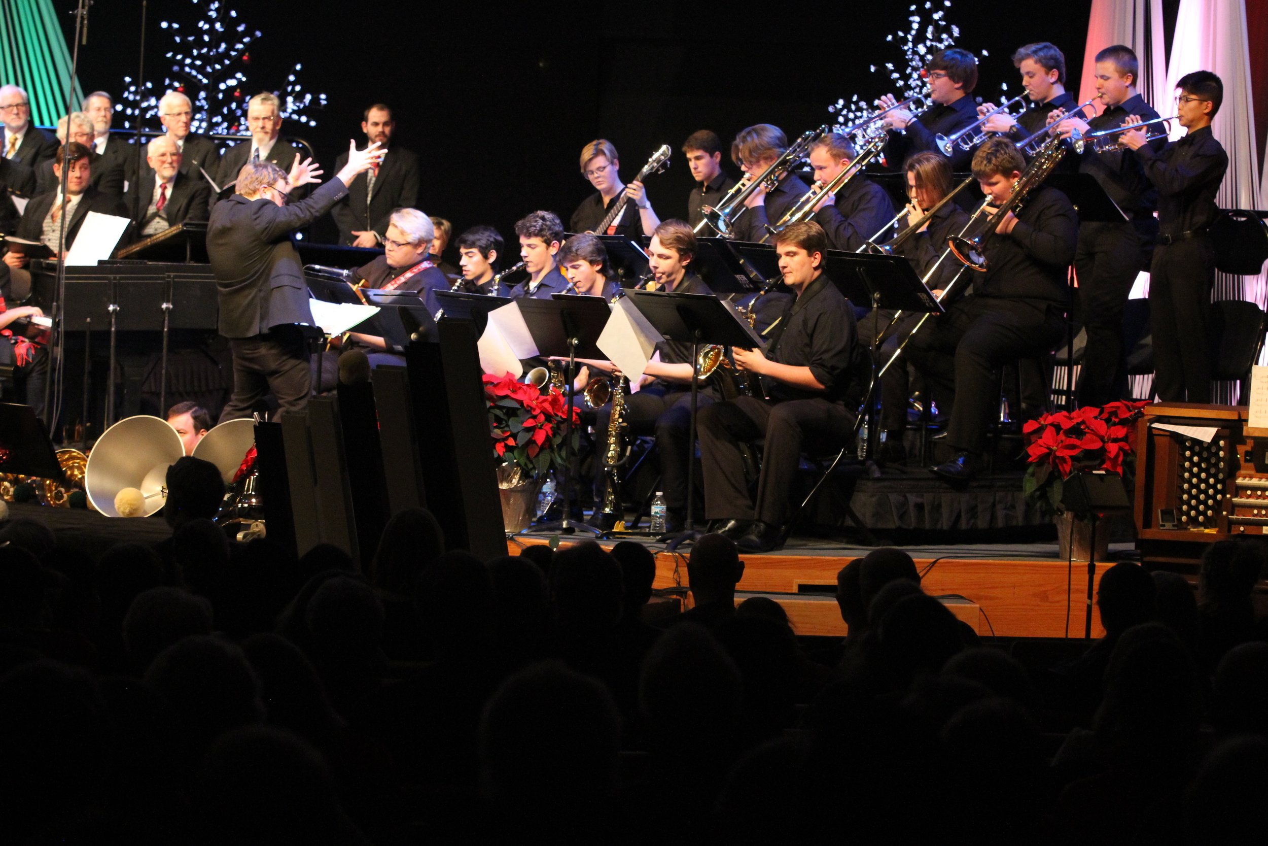 "Kalamazoo Youth Jazz Orchestra director Benje Daneman leads his students on stage at the ""Christmas in Kalamazoo"" concert with the Kalamazoo Male Chorus and the Kalamazoo Ringers in December 2018."