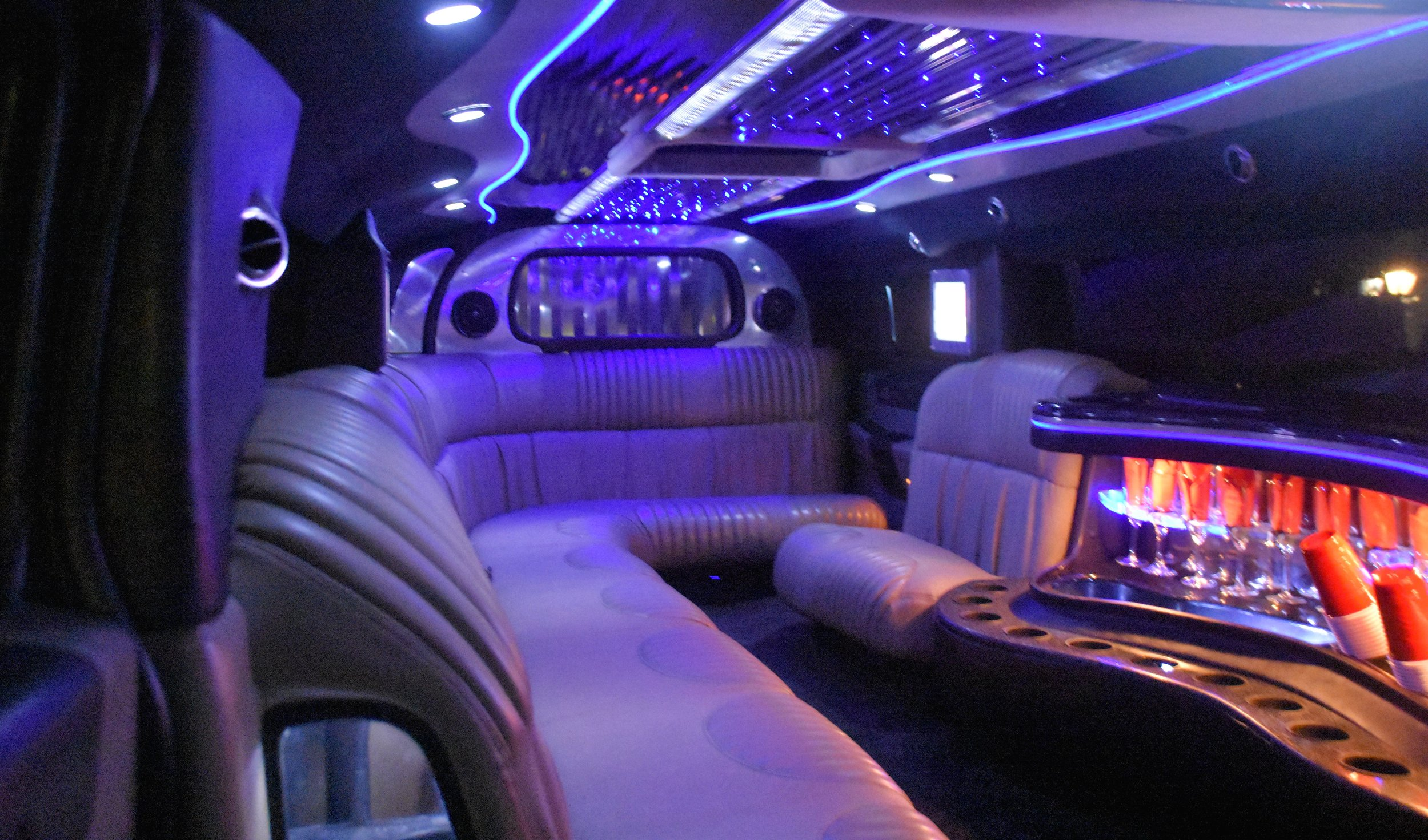 Ride in style in our HUMMER,10-12 adults comfortable, 14 children or students. With 5th door for easy entry for all passengers -