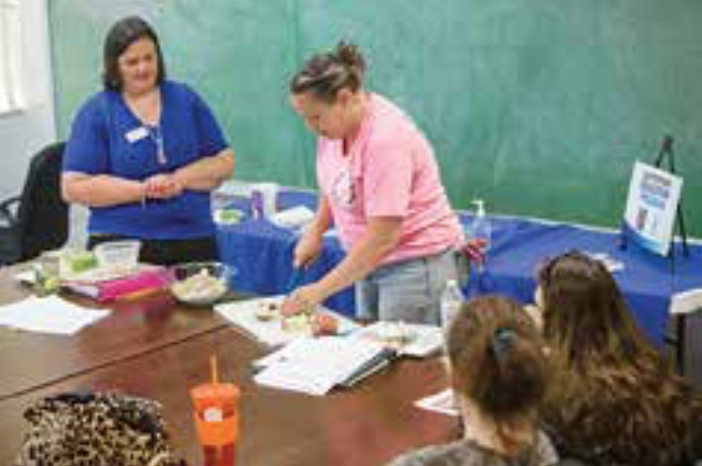 Nutrition classes led by Kacy Wiley (l) have changed the way Ali Sanders (r) shops and cooks. Photo by Stephen Patton