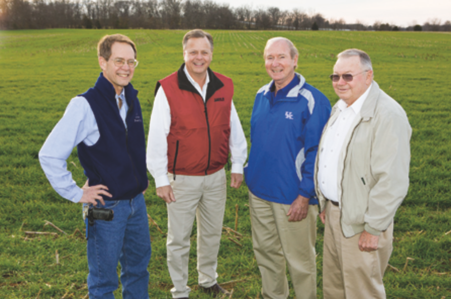 Steve Hunt (second from left) and father Wayne Hunt (right) have seen dramatic yield increases in their years as wheat growers, due in part to research conducted by College of Agriculture specialists David Van Sanford (left) and Lloyd Murdock (second from right).