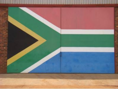The South African flag painted on an equipment shed at Beestepan Farm.