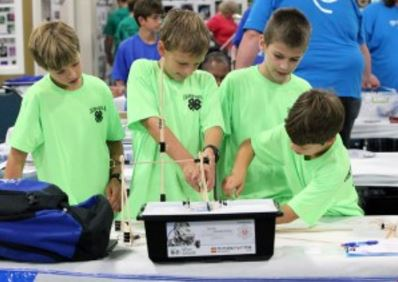 4-H students from Caldwell County work on a project as part of the Science and Technology day held at Cloverville during the recent Kentucky State Fair.