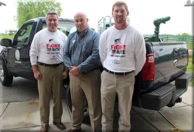 From left, Agriculture Commissioner Ryan Quarles; John Cook executive director of the Kentucky Department of Agriculture's Office of Consumer and Environmental Protection; and David Wayne, director of the Division of Environmental Services, stand in front of a pickup truck outfitted with an ultra-low-volume fogging machine.(Kentucky Department of Agriculture photo)