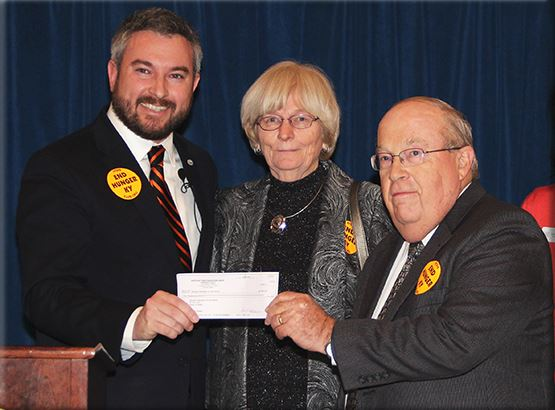 Bonnie Jolly, center, executive director of the Kentucky Pork Producers Association, and KPPA President Dennis Liptrap, right, donated a check for $5,000 from the KPPA to the Kentucky Association of Food Banks for purchasing pork products for distribution by KAFB member organizations. Agriculture Commissioner Ryan Quarles is at left.