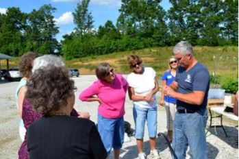 Ted Johnson, Lee County extension agent, shows participants at his raised bed gardening workshop how to install irrigation.  PHOTO: Katie Pratt, UK Agricultural Communications