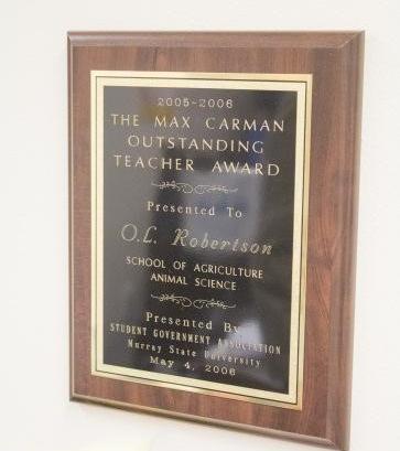 The 2005 – 2006 Max Carman Outstanding Teacher Award still hangs proudly in Robertson's office. Photo: McKenna Dosier