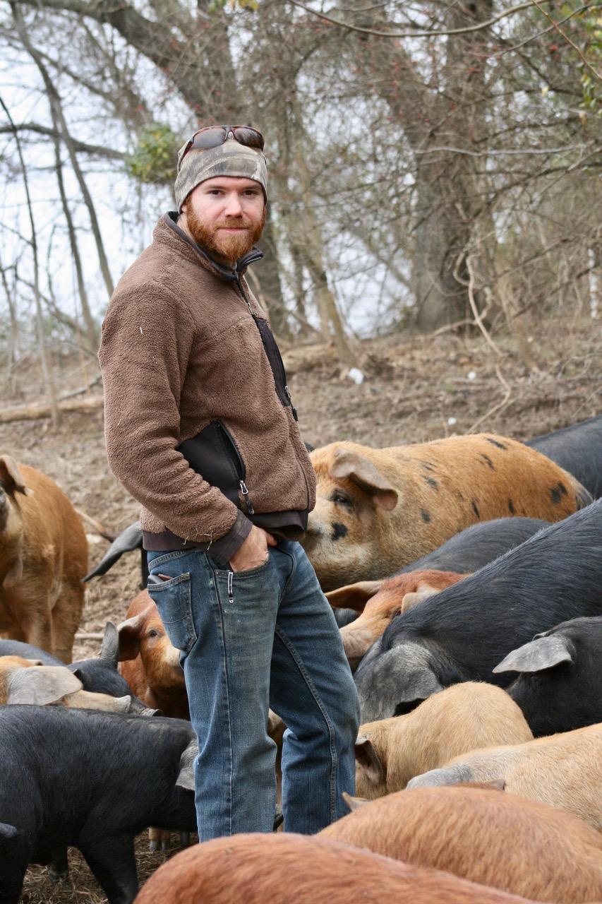 Tyler Green raises hogs on his farm in Garrard County.