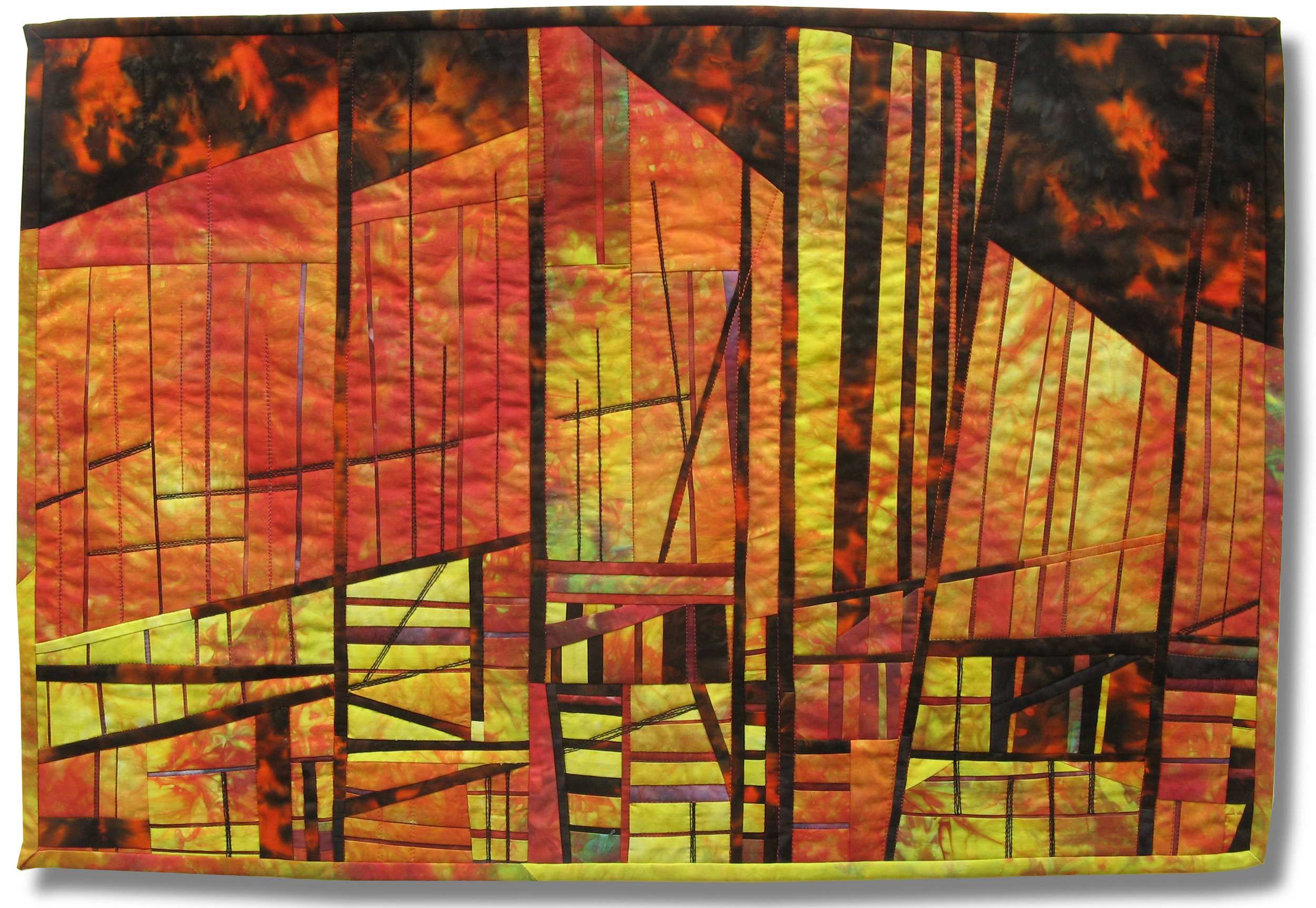 "Mountain Blaze - PLaying with fire - 27.5"" x 19""Second Place, Original Design Abstract Pictorial Canadian Quilt Association National Juried Show 2015This art quilt was inspired by an article and picture about the destructive forest fires in Northern Alberta that was published in the Calgary Herald in the summer of 2012. I love the contrast between the orange and black in a linear way - also the contrast between the horizontal and vertical trees on fire. I incorporated my own dyed fabrics into the piece."