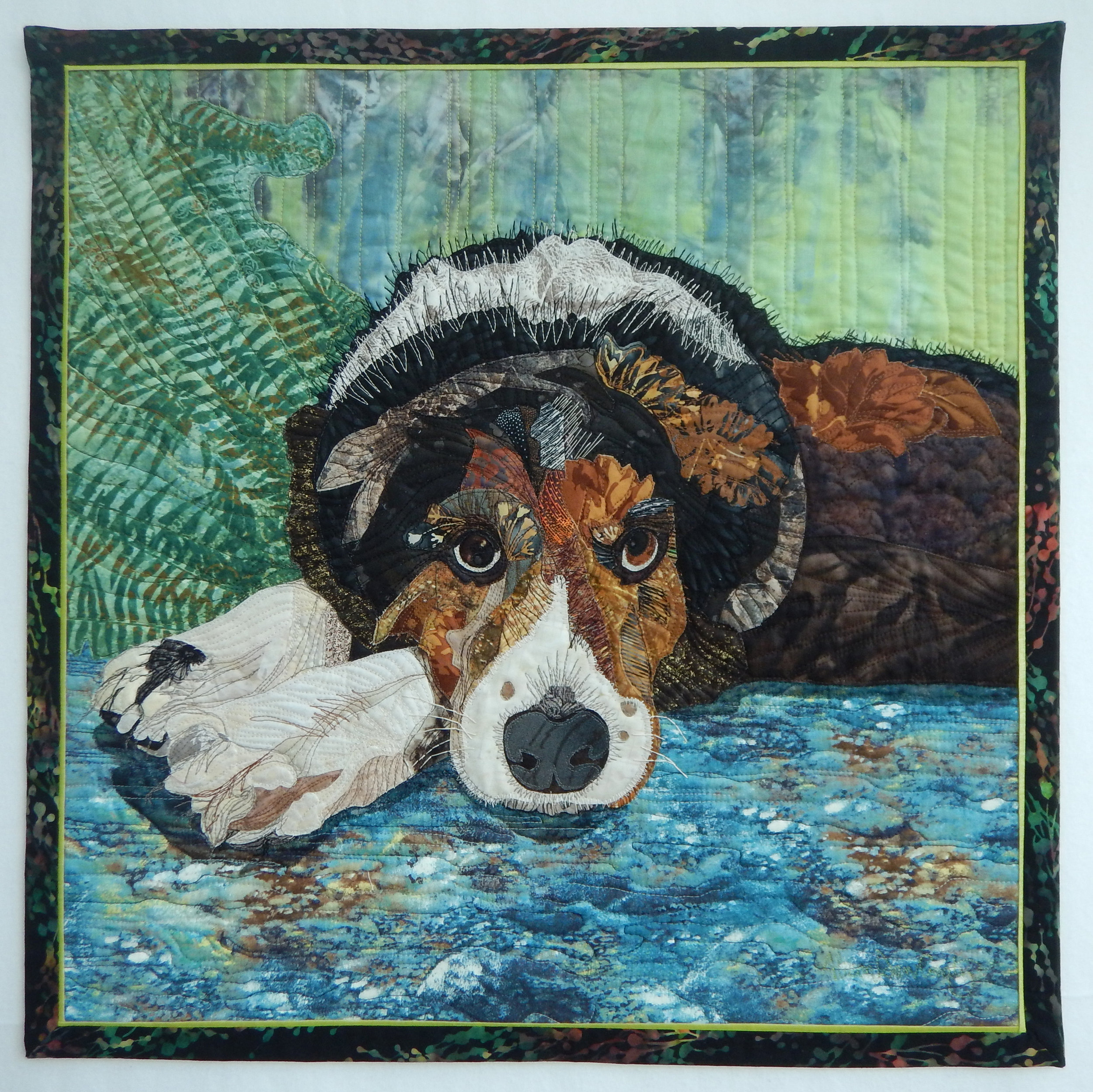 "Leo - 23"" x 23""Accepted into the Canadian Quilters' Association National Juried Show 2016With much meaning and gratitude this portrait was brought to life. A physician and friend was intrigued with my previous work using fabric as an art medium and she asked me to make a portrait of her Border Collie, Leo. He is a beloved family pet who is in his twilight years. It was my goal to communicate his loyal and gentle spirit in fabric. For me it comes alive when I get the eyes right!"