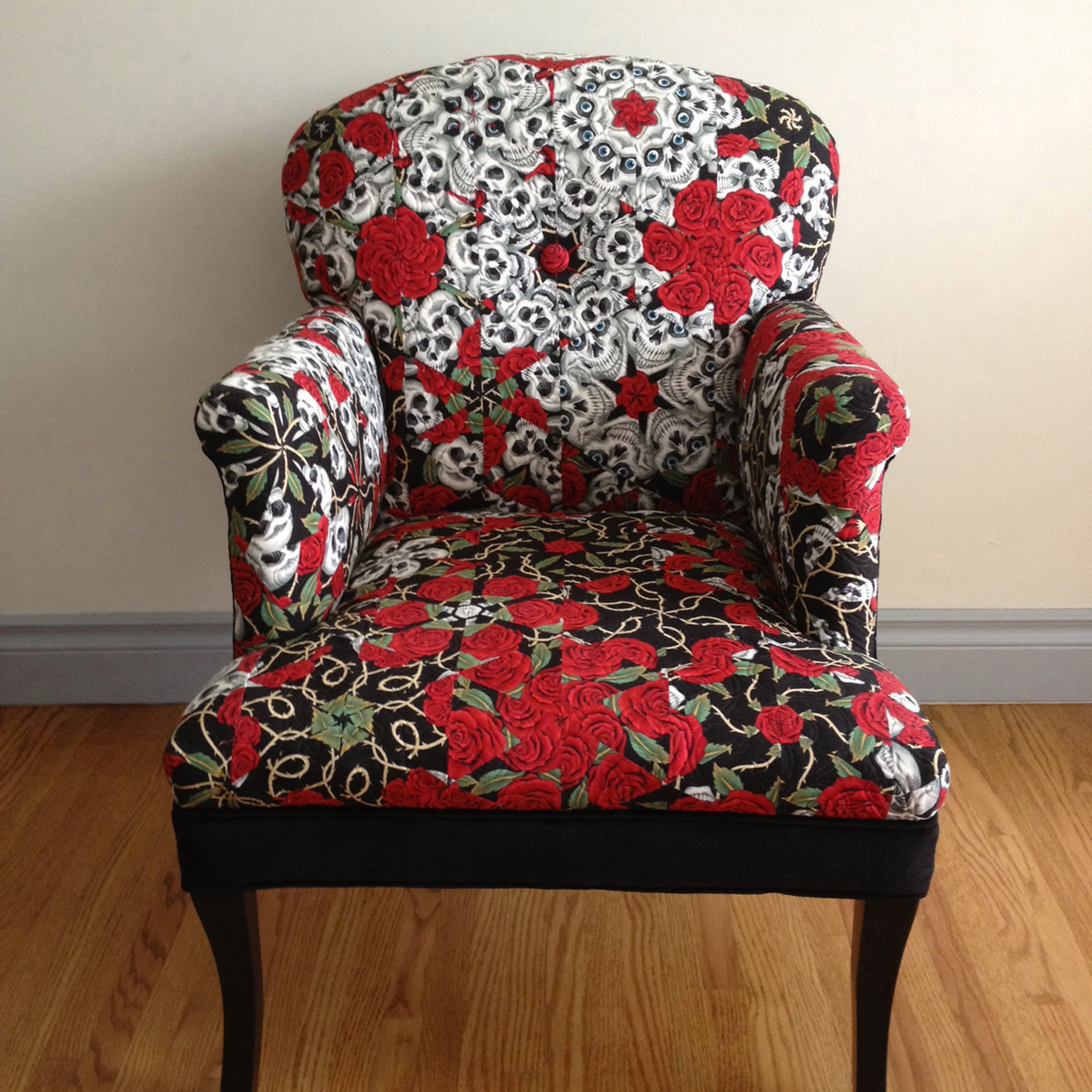 Chair - I had this idea to re-upholster a chair with a One-Block-Wonder quilt design. If you look closely you can see the surprise in the pattern.Learn my process by reading my blog post.