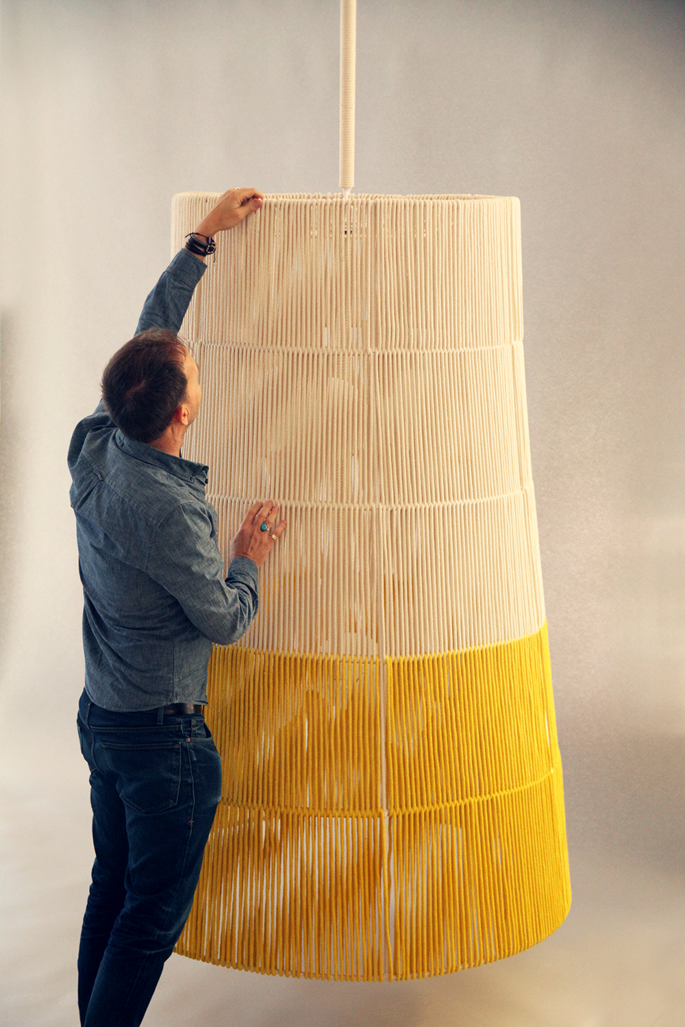 Rope_C-182_Horizon String Tapered Pendant_Large_Yellow_with Chad.jpg
