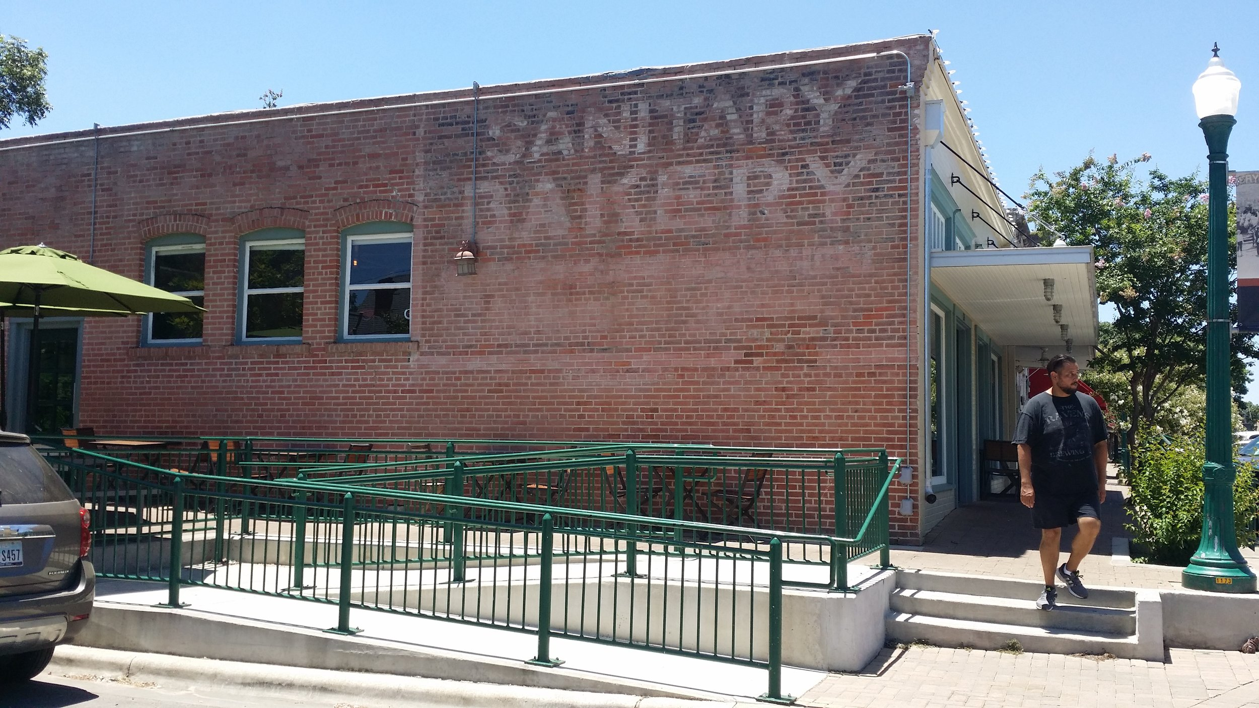 """Existing Conditions-Very faded sign, only """"Sanitary Bakery"""" were easily legible."""