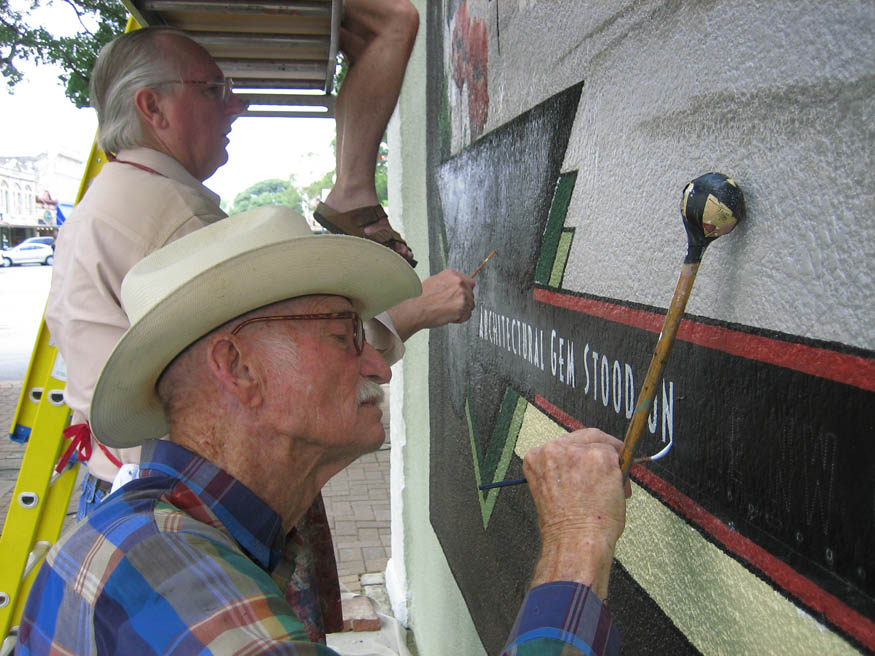 Hollace Baker and his son Gordan Baker using traditional sign painting methods.