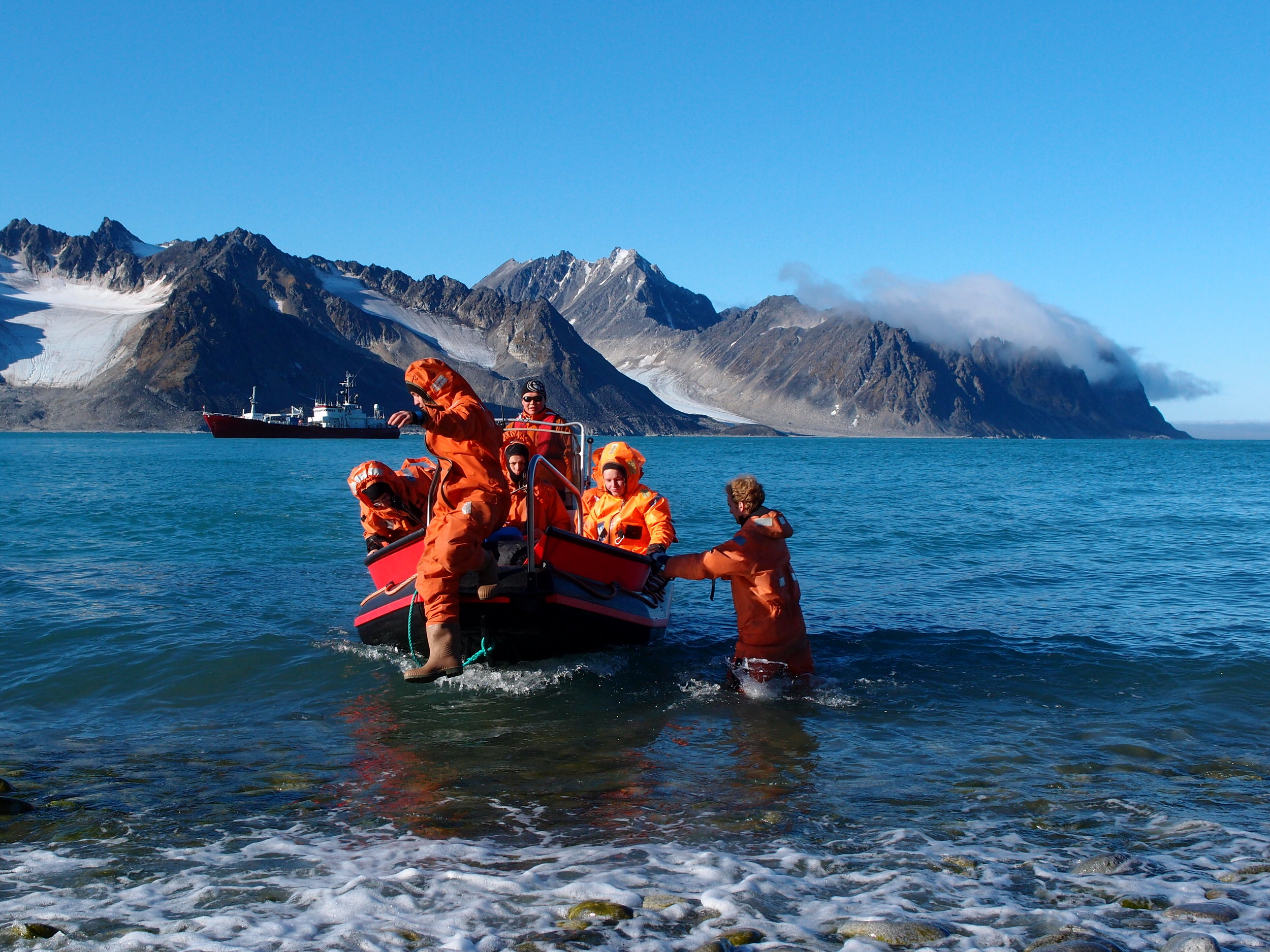 Svalbard is increasingly popular among tourists and scientists alike, also in summertime. But even if ocean temperatures are above freezing, survival suits are a must when landing on Svalbard's shores. Photo: Steve Coulson / UNIS