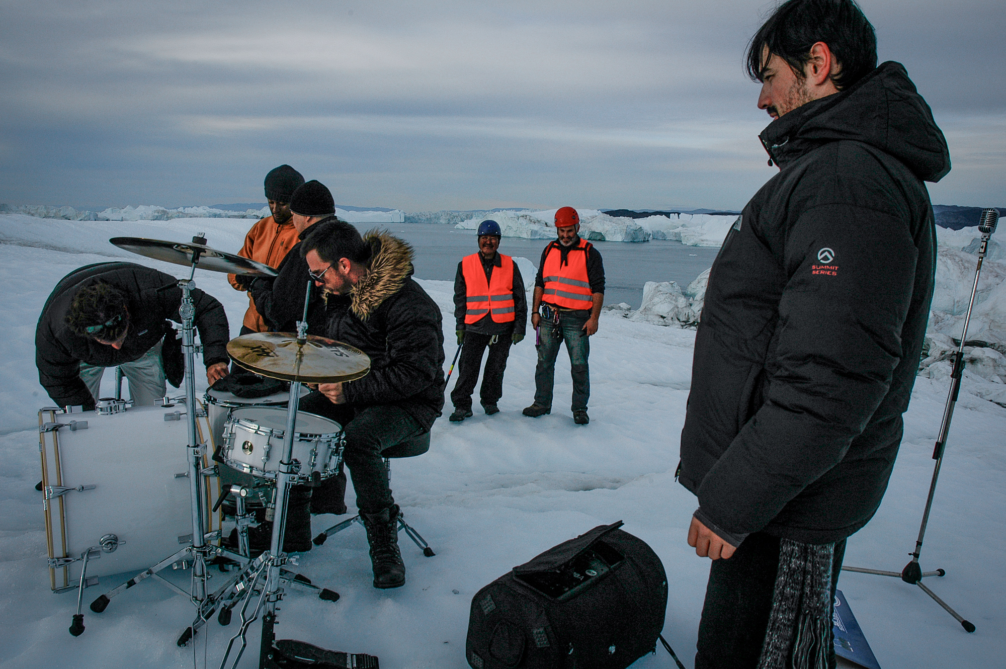 "The locations & safety team, Ulrik Sanimuinaq and Denni Reynisson (center) on top of a giant iceberg in Ilulissat in North-West Greenland. This production was for a music video to ""A Beautiful Lie"" by 30 seconds to Mars, directed by Jared Leto. JONAA©Kristjan Fridriksson."