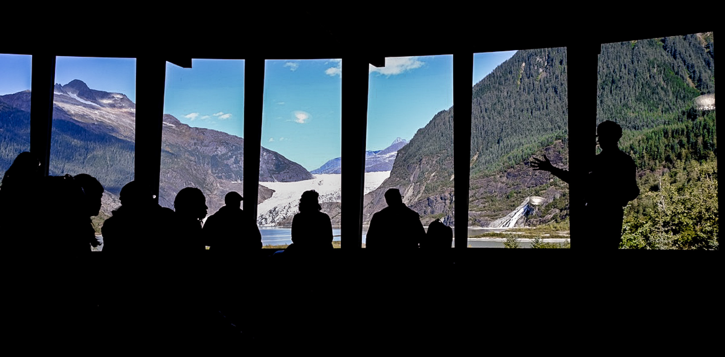 Director John Neary speaks to the Arctic-FROST group at the Mendenhall Glacier Visitor Center.  JONAA©Mia Bennett