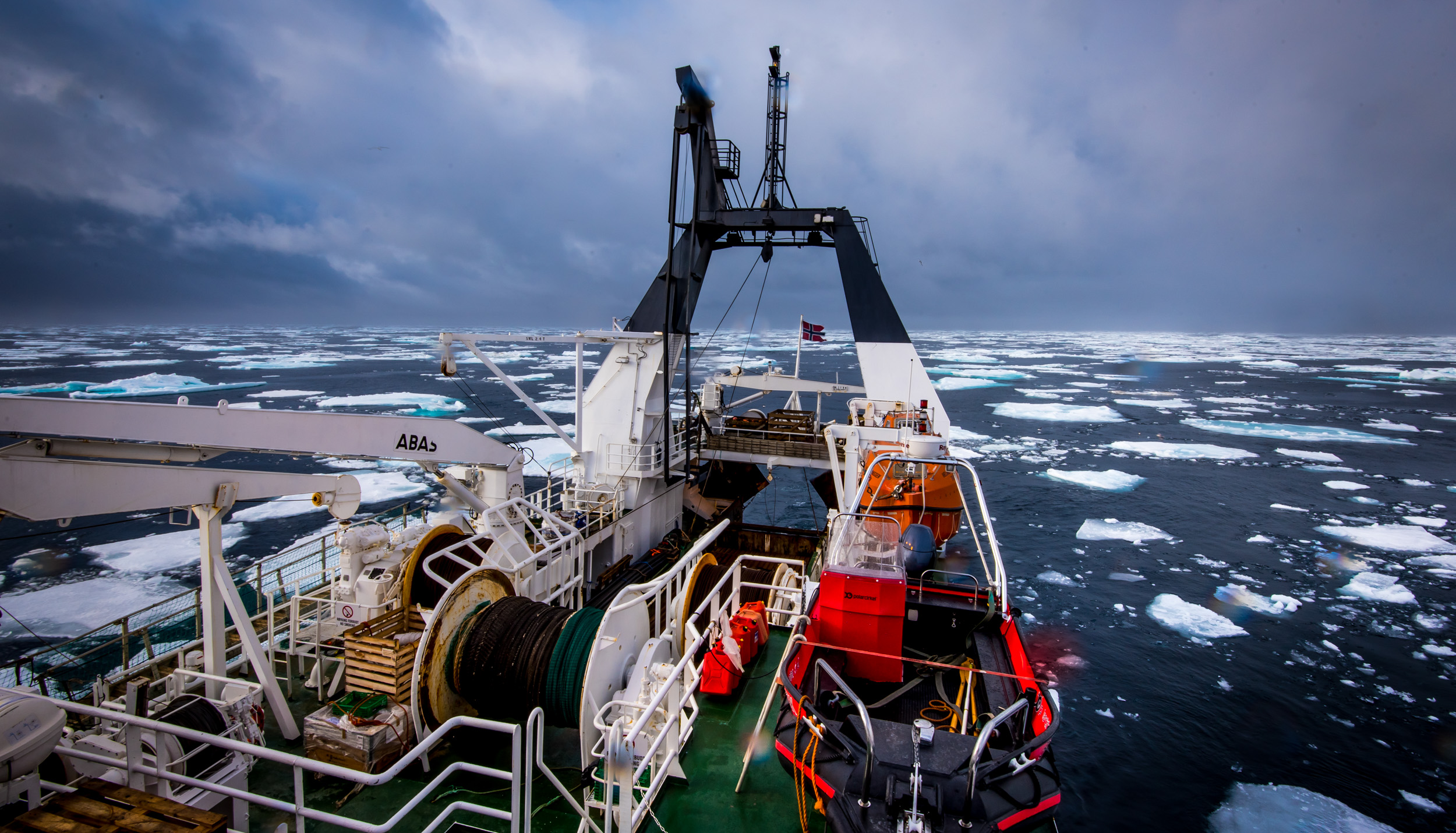 """Scientific research vessel """"Helmer Hanssen""""  in the Arctic Ocean. Warm seas produce less sea ice north of Svalbard, bringing about changes to the marine environment.  JONAA©Elvar H. Hallfredsson"""