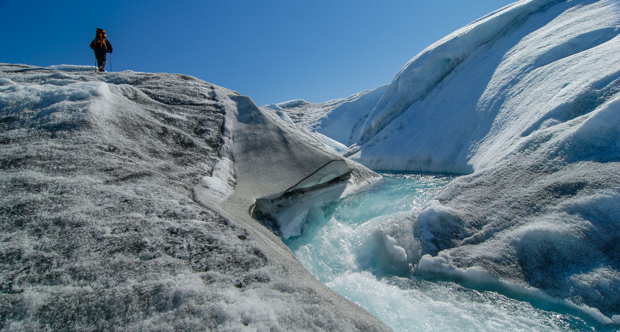 Warmer air temperatures and darker glacier surfaces that absorb incoming sun radiation instead of reflecting it,  are both growing contributers to increased glacier melt.  JONAA©Kristjan Fridriksson