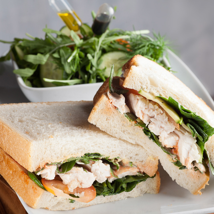 Closed Sandwiches from various Jack Cuthbert Breads, with Joe's Farm Crisps or Rocket Salad