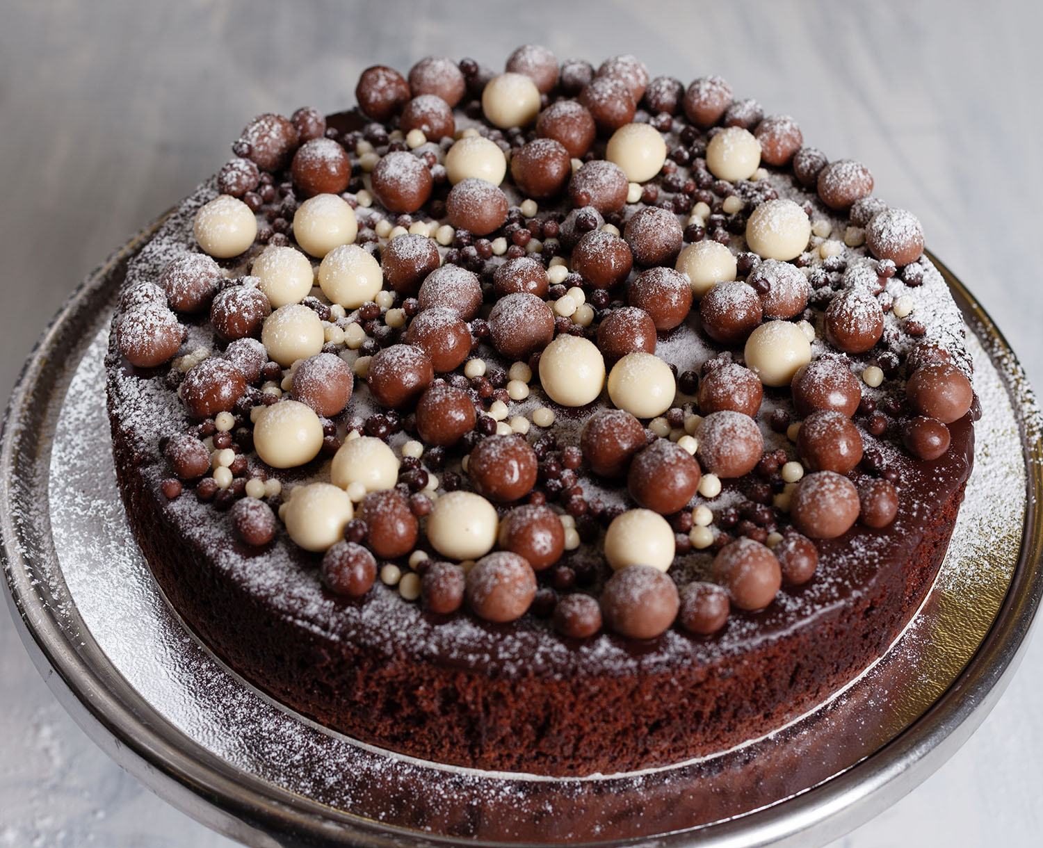 Baked Chocolate Fudge Cake Topped with Chocolate Ganache and Maltesers