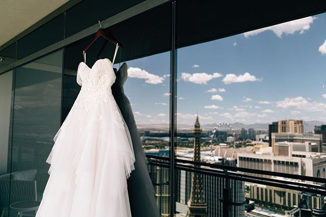 Gorgeous dress and a view! If you are staying at a hotel, make sure to book yourself a big enough room with lots of natural light for getting ready the morning of your wedding day. You want enough space for all your tribe and your glam squad. Anything with a view or a balcony is just icing on the cake ✨  Planner: @storybookeventslv  Photographer: @nima_photography  Dress: @thewhitemagnolia