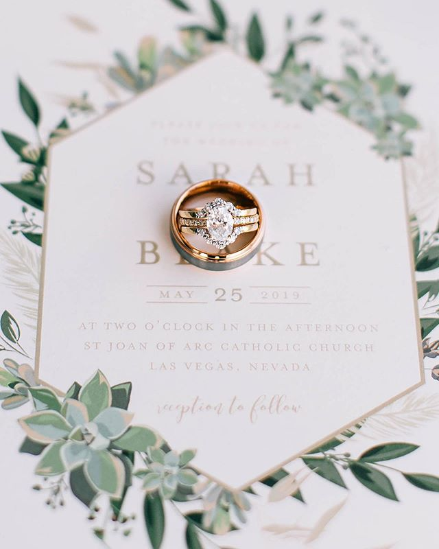 I love how Sarah chose two bands to add some gorgeous vintage flair to her already stunning engagement ring!  Remember to have both rings (you can hand them to the best man after), your vow books, invitation suite and any other gorgeous wedding day details with you so your photographer can capture them all.  Planning & Design: @storybookeventslv  Photographer: @nima_photography  Invitation: @minted @mintedweddings