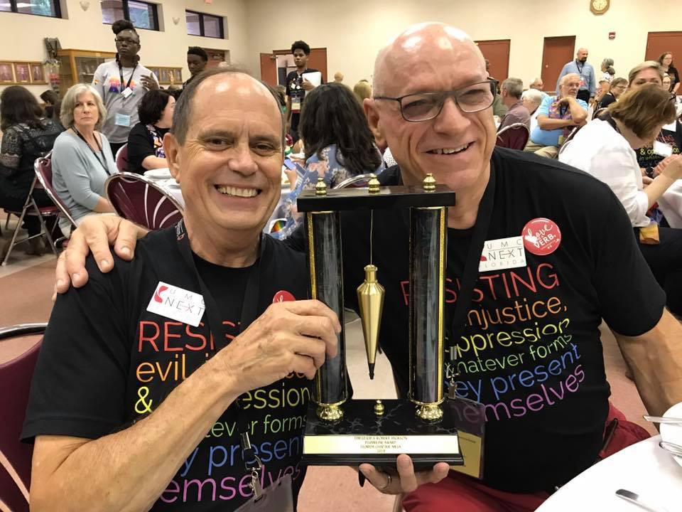 BJ and Tim won the Plumb Line Award for promoting love and justice for all people