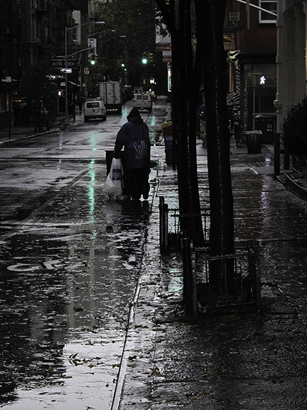 Worker in rain Home Page small.jpg