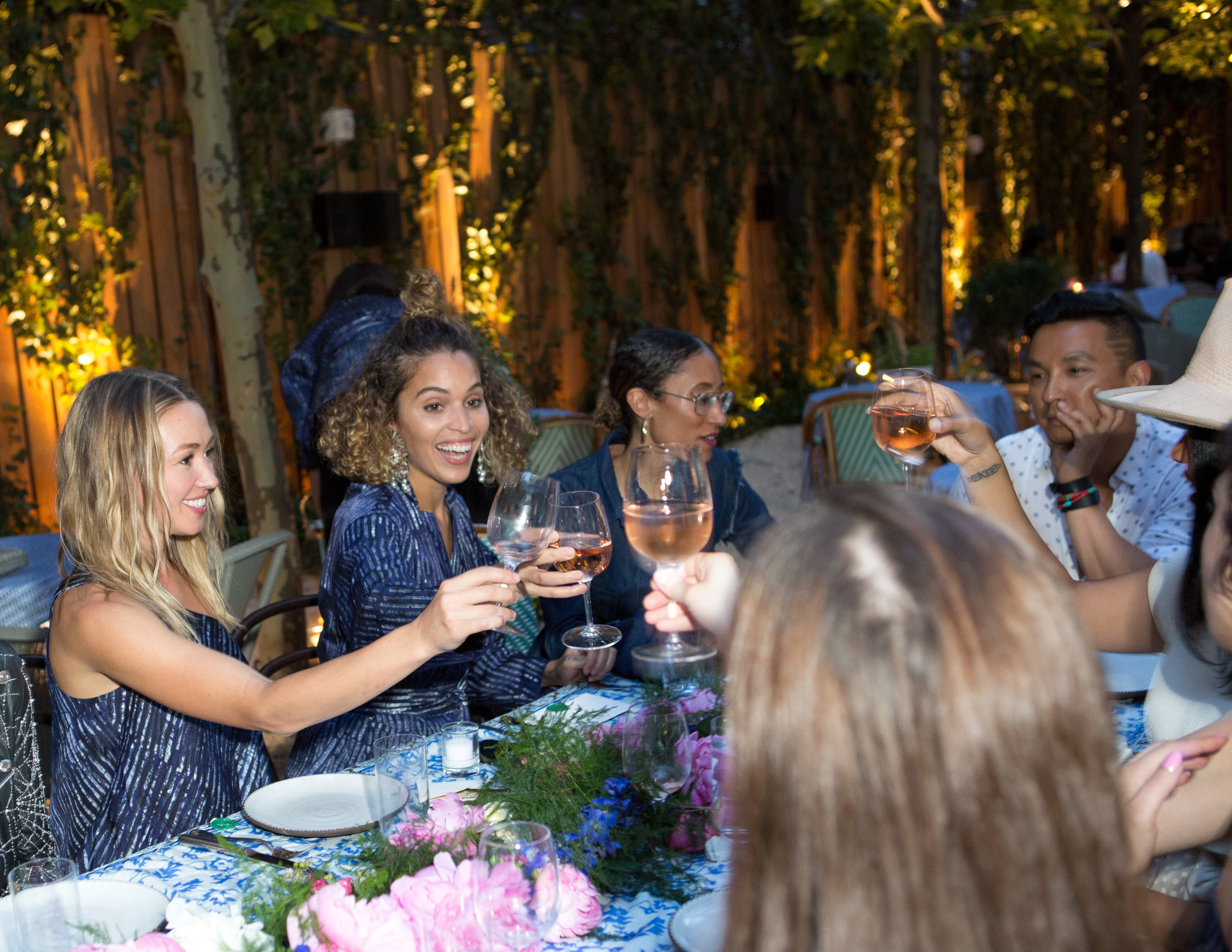 Left to right: Kate Greer, Cleo Wade, Elaine Welteroth, and Prabal Gurung toasting to a more sustainable and inclusive future.