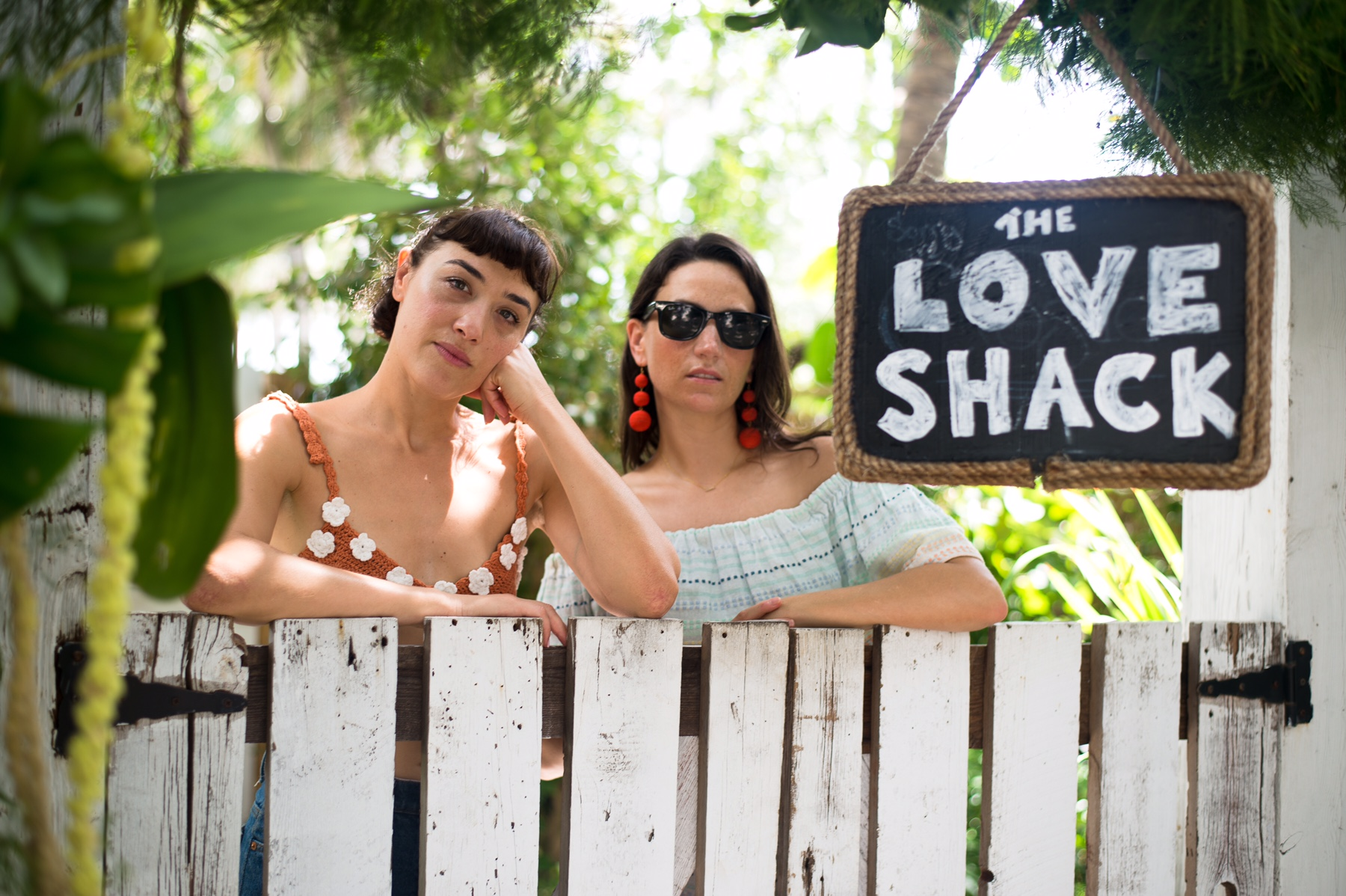 Mia Moretti and Piece & Co. CEO and Founder, Kathleen Wright, in front of the Love Shack Presentation at Miami Swim Week where they led a conversation on sustainability in fashion.