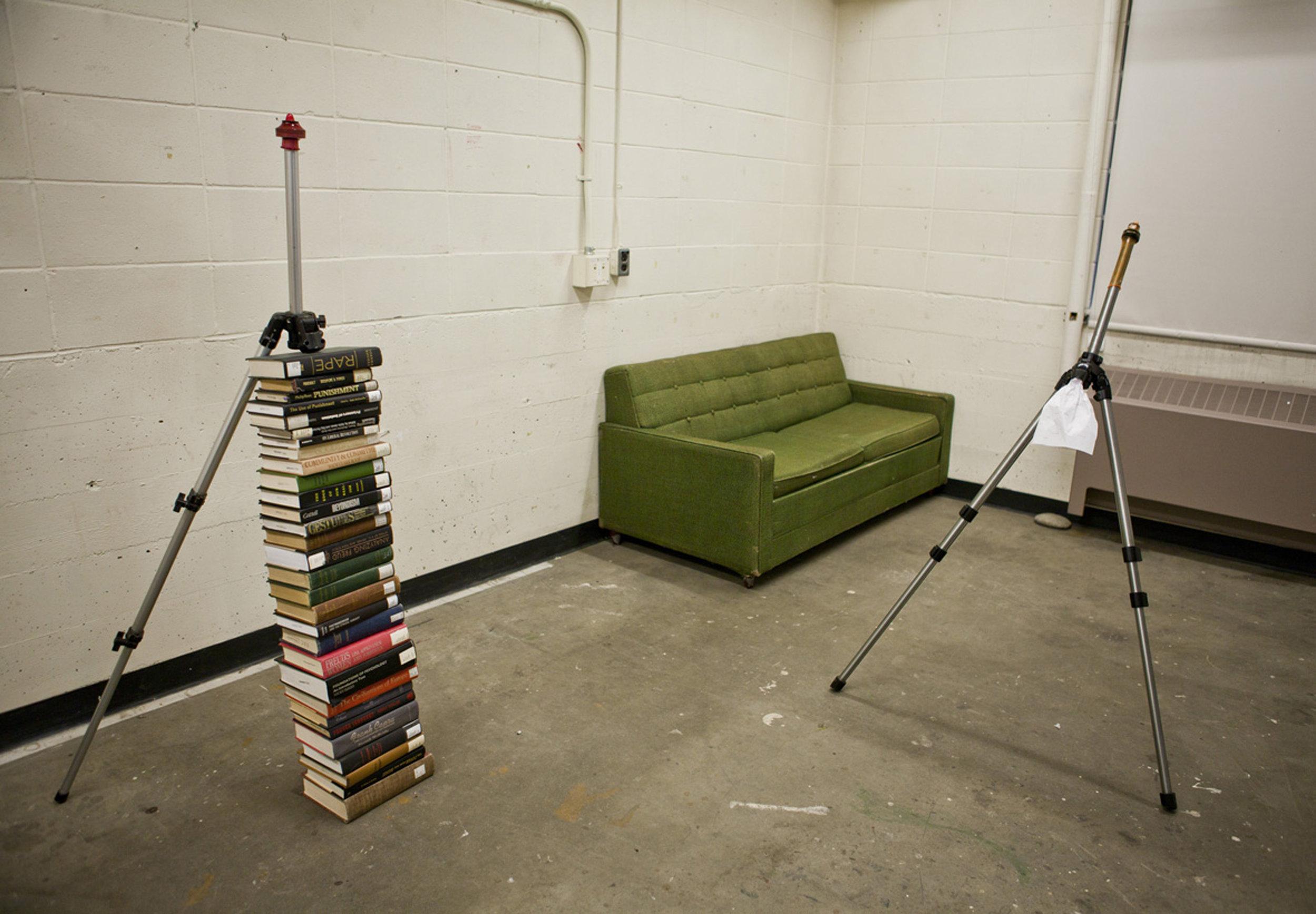 aluminum tripod, book, latex condom, 200 x 80 x 70 cm (Installation view)