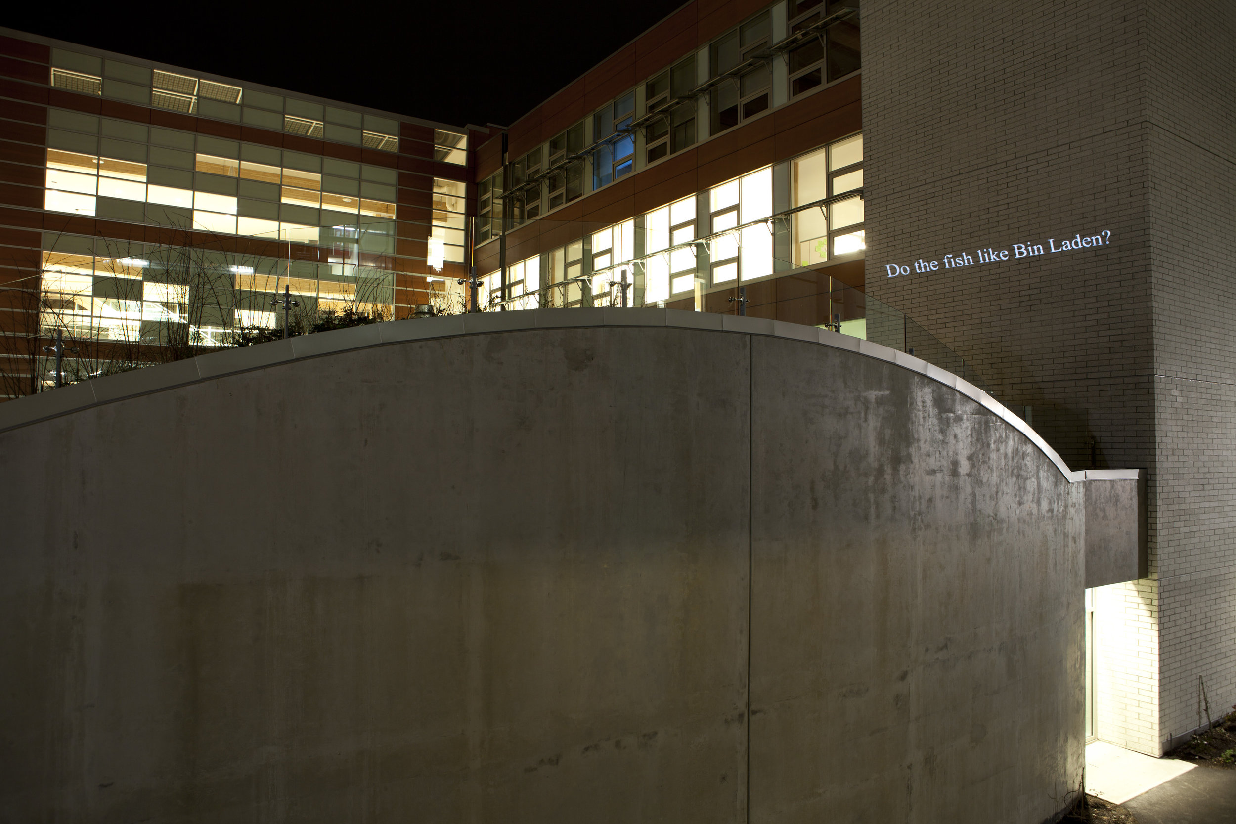 """HD Text projection onto UBC's building of  Centre for Interactive Research on   Sustainability. """"  Do the Fish Like Bin Laden? """""""
